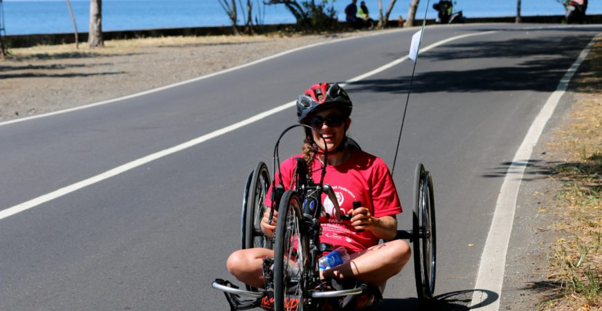 person on handcycle
