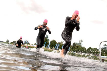 Swimmers get ready to swim in the Dorney Lake wearing wetsuits