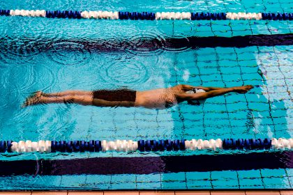 man swims in a lane in a swimming pool