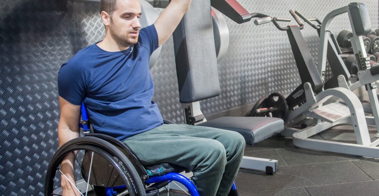 Ben Clark, tetraplegic swimmer, training for his 10km swim at the gym