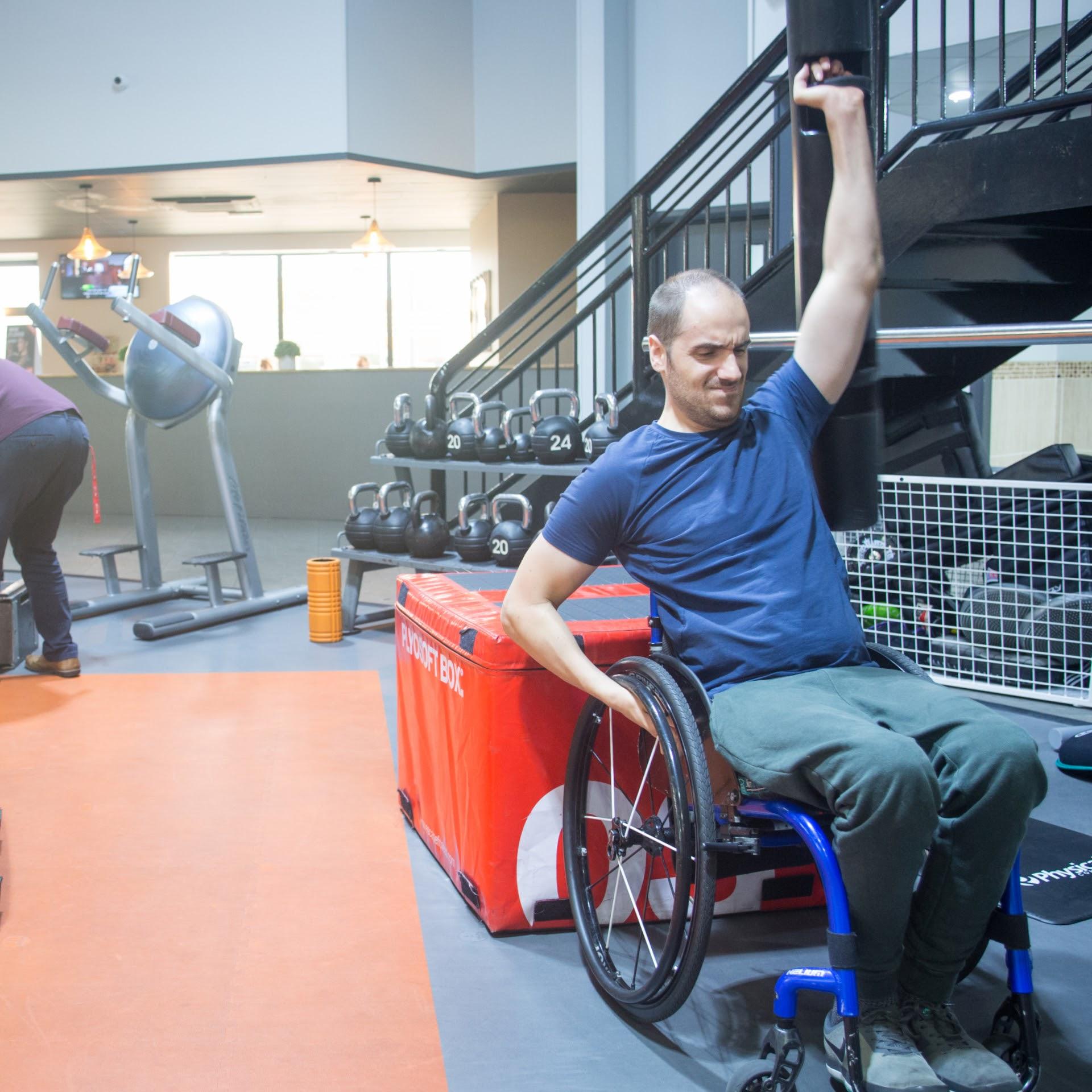 Ben Clark, tetraplegic swimmer, practices strength training at the gym for his 10km tetraplegic swim