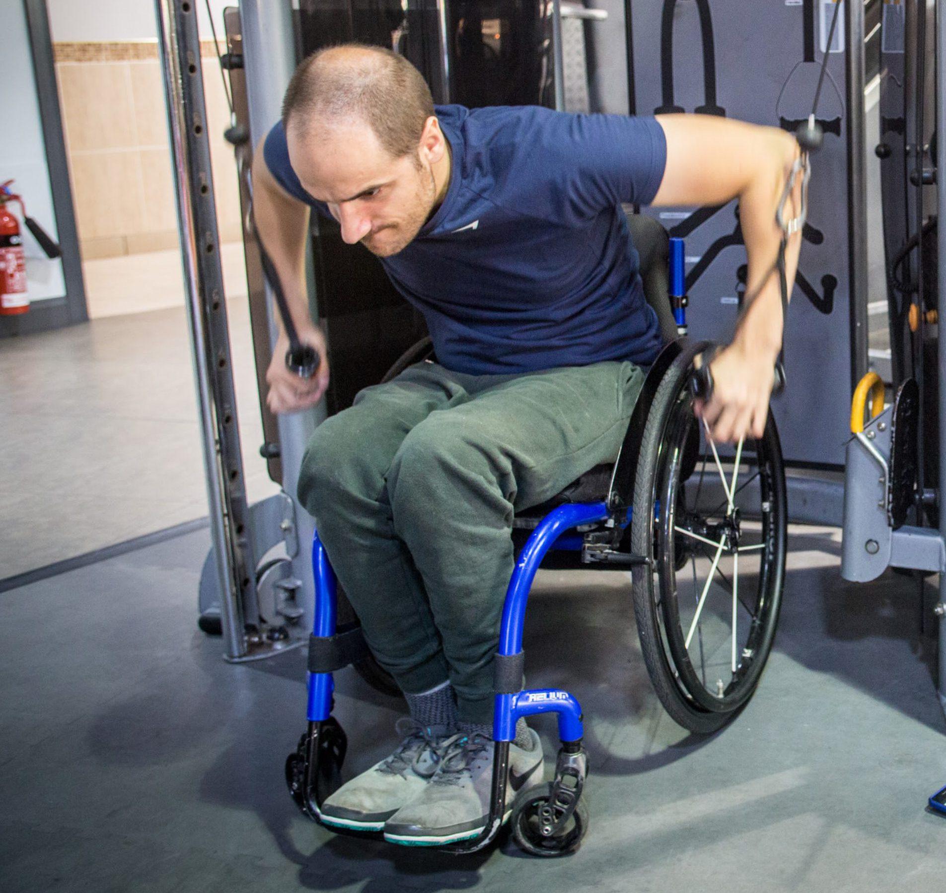 Ben Clark practicing strength training at the gym in preparation for his 10km tetraplegic swim