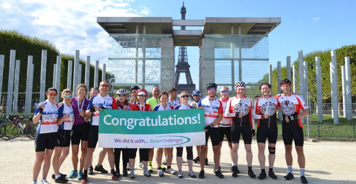 Group of Dream Challenges participants celebrate in front of the Eiffel Tower in Paris